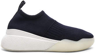Stella McCartney Loop Sock Sneakers in Dark Blue, Black & White | FWRD