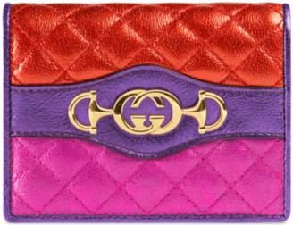 Gucci Supreme canvas card case with Flora print
