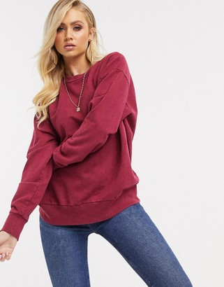 Asos Design DESIGN oversized washed sweatshirt in burgundy