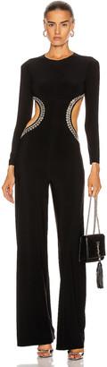 Norma Kamali Stud Long Sleeve Side Cut Out Jumpsuit in Black | FWRD