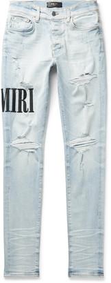 Amiri Skinny-Fit Logo-Embroidered Distressed Stretch-Denim Jeans