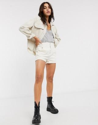 Bershka high rise elasticated waist shorts with roll hem in white