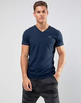 Hollister V-Neck T-Shirt Slim Fit Icon Logo in Navy