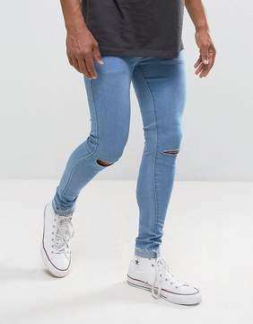 Criminal Damage Muscle Fit Super Skinny Jeans With Knee Rips And Raw Hem