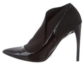 Christian Dior Asymmetrical Patent Leather Booties