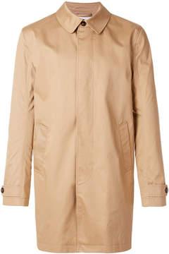Closed buttoned raincoat