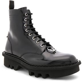 Neil Barrett Leather Piercing Boots in Black.