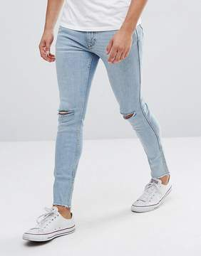MANGO Man Skinny Jeans With Rips In Light Wash