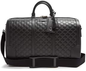 Gucci Logo-debossed leather holdall