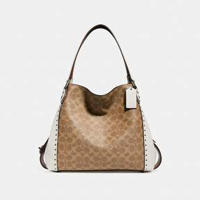 COACH COACH EDIE SHOULDER BAG 31 IN SIGNATURE CANVAS WITH RIVETS - CHALK/BLACK COPPER