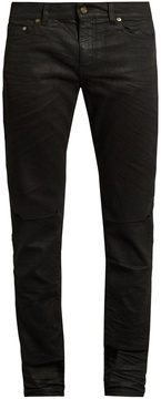 SAINT LAURENT Distressed coated skinny jeans