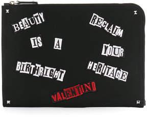 Valentino appliqué slogan clutch