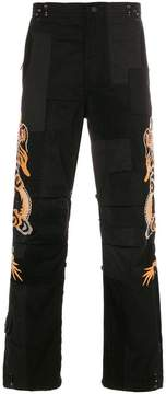 MHI dragon embroidered trousers