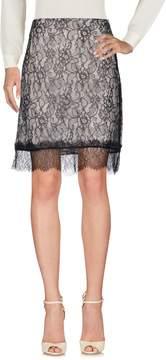 Clu Knee length skirts