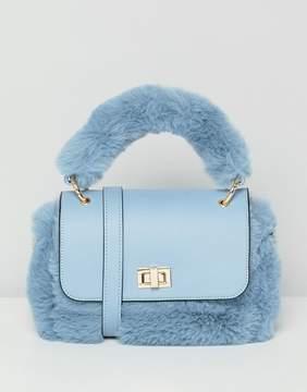 Asos DESIGN mini faux fur bag with detachable strap