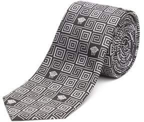 Versace Men's Slim Silk Tie Repeating Medusa Pattern Black.