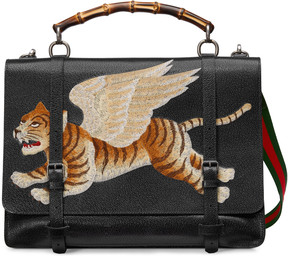 Leather briefcase with tiger
