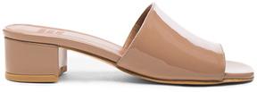 Maryam Nassir Zadeh Patent Leather Sophie Slide Heels in Neutrals.