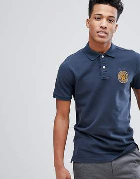 Abercrombie & Fitch Heritage Varsity Badge Logo Slim Fit Polo in Navy