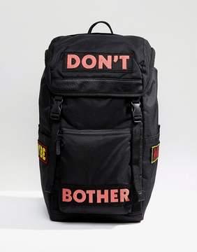 Asos Hiker Backpack In Black With Slogan Print