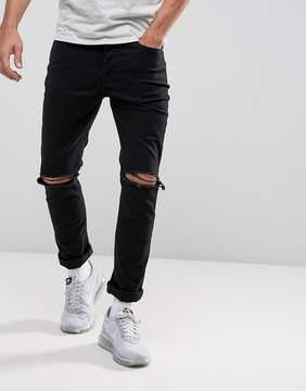 Hype Muscle Fit Skinny Jeans In Washed Black With Knee Rips