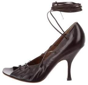 Alaia Leather Lace-Up Pumps