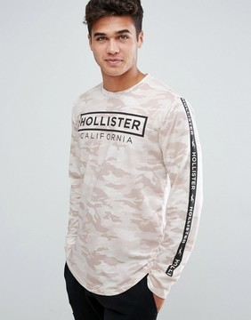 Hollister Long Sleeve Top Athleisure Logo Sleeve Print in Cream Camo