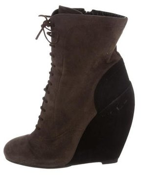 Alaia Lace-Up Wedge Ankle Boots
