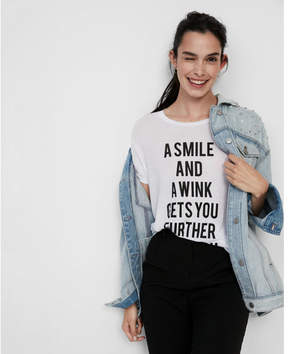 Express a smile and a wink crew neck graphic tee