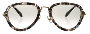 Miu Miu Marbled Round Sunglasses