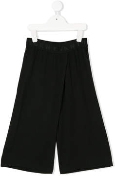 DKNY logo print trousers
