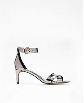 Express metallic low heel pumps