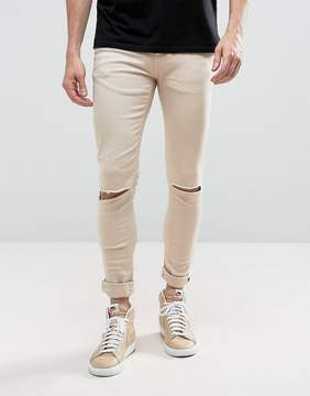 Criminal Damage Muscle Fit Super Skinny Jeans With Knee Rips