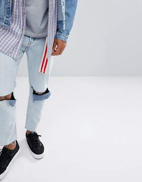 Cheap Monday In Law Tapered Jeans in Tom Blue with Blown Out Knee