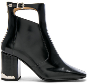 Toga Pulla Leather Boots in Black.