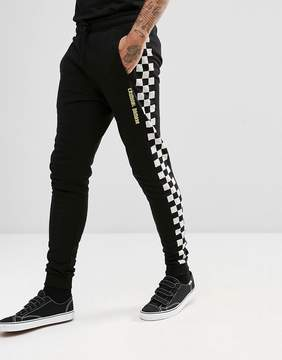 Criminal Damage Skinny Joggers In Black With Checkerboard Stripe