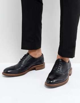 Dune Pebble Brogues In Black Leather