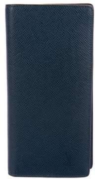 Louis Vuitton Taiga Vertical Wallet