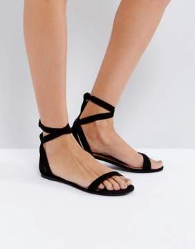 Call it SPRING Caderasen Black Nubuck Flat Sandals