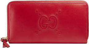 Gucci Embossed GG zip around wallet - HIBISCUS RED GG LEATHER - STYLE