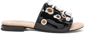 Toga Pulla Patent Leather Sandals in Black.