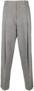 McQ dogtooth patch patterned tapered trousers