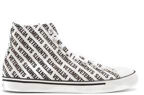 Vetements Logo-print high-top canvas trainers