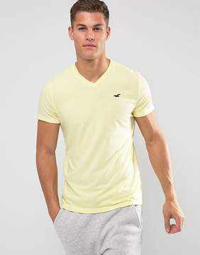 Hollister V-Neck T-Shirt Slim Fit Core Icon Logo in Yellow