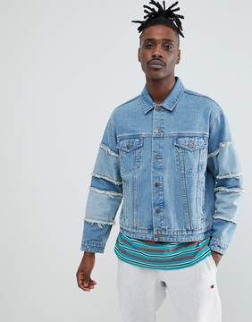 Asos DESIGN festival oversized denim jacket with frayed sleeve in blue Wash