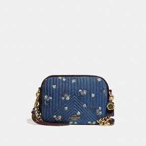 COACH COACH CAMERA BAG WITH FLORAL BOW PRINT - DENIM/BRASS