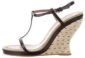 Alaia Patent Leather Wedge Sandals