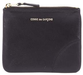 Comme des Garcons Men's Black Leather Wallet.