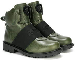 Young Versace boots with front band detail