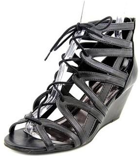 Material Girl Hera Women Open Toe Synthetic Black Wedge Sandal.